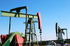 Oil pumps jacks under blue sky Stock Photos