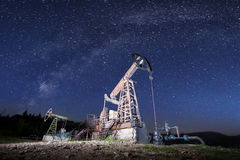 Oil pumps on the oil field in the night royalty free stock photo