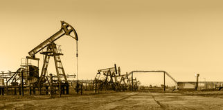 Oil pumps on a oil field. Royalty Free Stock Photos