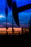 Oil pumps at oil field with sunset sky background Royalty Free Stock Photo