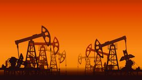 Oil pumps over sunset. Royalty Free Stock Photos