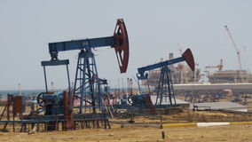 Oil Pumps, Pump jack. Fossil Fuel Energy, Old Pumping Unit stock video