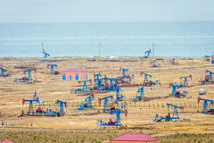 Oil pumps and rigs by the Caspian coast Royalty Free Stock Photography