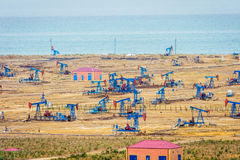 Oil pumps and rigs by the Caspian coast Royalty Free Stock Images
