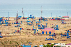 Oil pumps and rigs by the Caspian coast stock photos