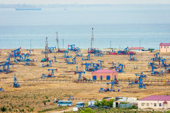 Oil pumps and rigs by the Caspian coast Royalty Free Stock Image