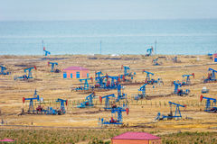 Oil pumps and rigs by the Caspian coast Stock Image