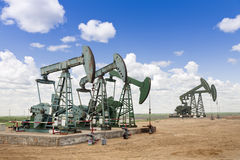 Oil pumps. A row of big steel oil pumps Royalty Free Stock Photo