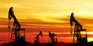 Oil pumps. Silhouette at colorful sunset Royalty Free Stock Photography