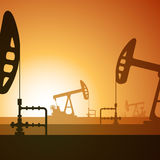 Oil pumps silhouette on sunset. Vector illustration of working oil well on sunset background Royalty Free Stock Image