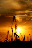 Oil pumps at sunset royalty free stock photo