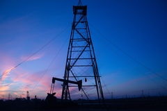 Oil pumps and sunset Stock Image