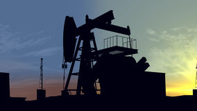 Oil pumps at sunset. Oil industry equipment. Royalty Free Stock Images