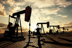 Oil pumps on the sunset sky Royalty Free Stock Photos