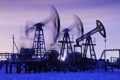 Oil pumps Stock Photos