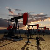 Oil pumps on the sunset sky Stock Photography