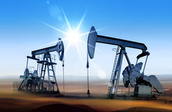Oil pumps at sunset Royalty Free Stock Photos