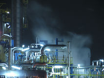 Oil rafinery. Oil refinery construction at night Royalty Free Stock Photo