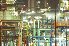 OIL RAFINERY. An oil refinery construction at night stock image