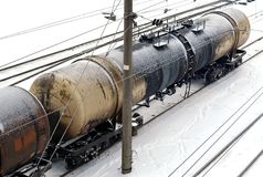 Oil railway tank. Dirty oil railway tank on snow-covered tracks Royalty Free Stock Photo