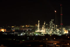 An oil refinery. On night background image Stock Photography
