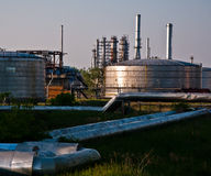 Oil refinery. And pipes under the afternoon sun Stock Images