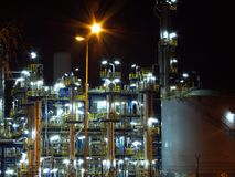 Oil refinery. Night oil refinery, night scene, light and oil refinery construction stock photo