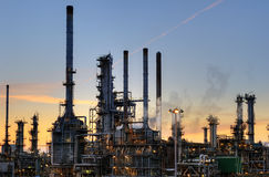 Oil refinery. Late at night with lights and smoke Royalty Free Stock Photos