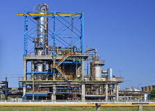 Oil refinery. View of oil petrochemical refinery pipes with clear blue sky Stock Image