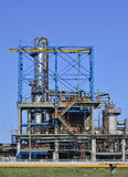 Oil refinery. View of oil petrochemical refinery pipes with clear blue sky Stock Photo