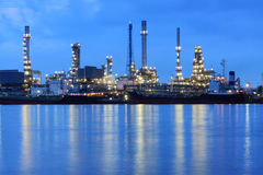 Oil refinery. Near the river at night Royalty Free Stock Image