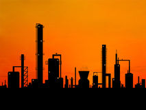 Oil refinery. Factory over sunrise Royalty Free Stock Photography