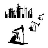 Oil Refinery. Isolated silhouettes of an oil refinery and oil wells in AI-EPS8 format royalty free illustration