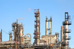 Oil Refinery. An oil refinery in operation with operational heat distorting some fixtures Stock Images