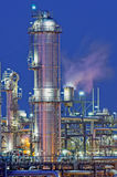 Oil Refinery. Tower and pipes of a chemical installation Stock Images