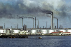 Oil refinery. Spewing toxic smoke off the coast of Mexico royalty free stock photography
