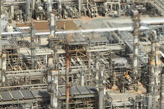 Oil Refinery Aerial. Aerial image of oil refinery featuring blurred fumes from stack royalty free stock images
