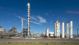 Oil refinery against blue sky Royalty Free Stock Photos