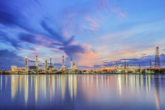 Oil refinery along the river at Dusk (Bangkok, Thailand) Royalty Free Stock Photo