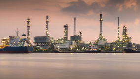 Oil refinery along the river during sunrise Stock Photo