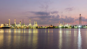 Oil refinery along with river before sunrise, Bangkok Thailand Stock Photos