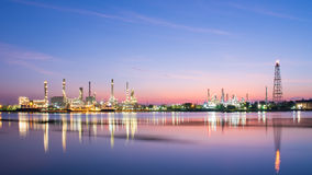 Oil refinery along the river. Stock Photography