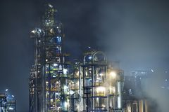 Oil refinery at blue night Stock Photography