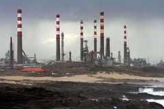 Oil Refinery By The Sea Stock Photos