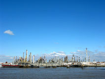 Oil Refinery with Chimneys on River Waterfront Stock Images