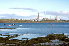 Oil refinery on the coast, Wales Stock Photography
