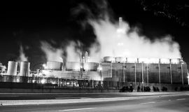 Oil refinery complex. An oil refinery in the United States with a series of foggy and smoky stacks. Complex releasing pollutants into the sky Stock Photo