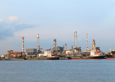 Oil refinery and container tanker ship in port use for petroleum Stock Photography