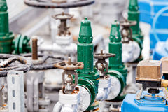 Oil refinery. Detail of oil pipeline with valves in large oil refinery royalty free stock photography