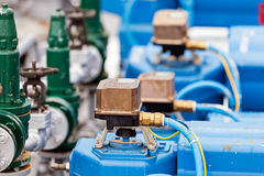 Oil refinery. Detail of oil pipeline with valves in large oil refinery stock photography